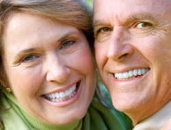 older couple smiling dental implants